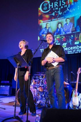John and Cindy Hooton, owners of Stargazers Theatre and Event Center, in their natural habitat - on stage introducing the next act.